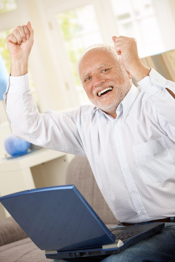 old-man-celebrating-with-a-laptop
